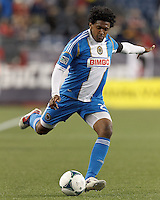 Philadelphia Union defender Sheanon Williams (25) crosses the ball. In a Major League Soccer (MLS) match, the New England Revolution (blue/red) defeated Philadelphia Union (blue/white), 2-0, at Gillette Stadium on April 27, 2013.