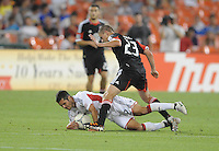 New England Revolution Benny Feilhaber (22) gets fouled by D.C. United midfielder Perry Kitchen (23) D.C. United defeated The New England Revolution 3-2 at RFK Stadium, Saturday May 26, 2012.