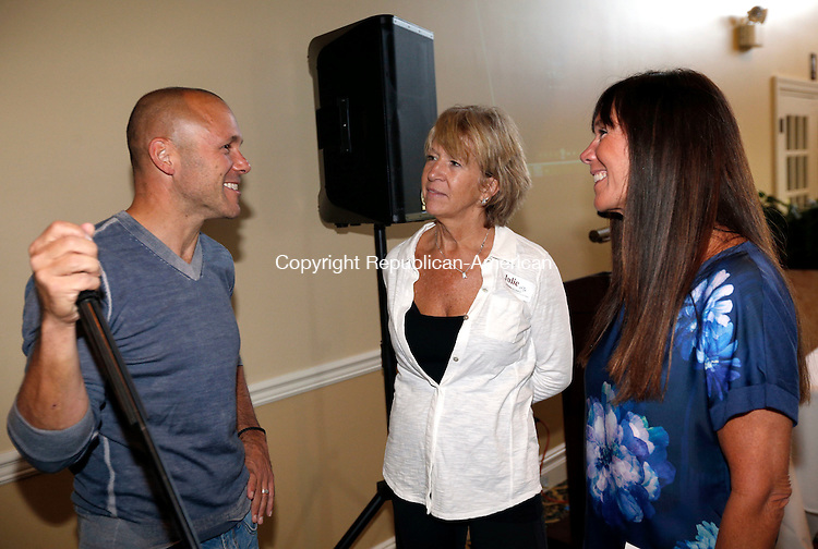 Goshen, CT- 25 September 2015-092515CM04-  Brian Mattiello, of Torrington, left, Julie DeMichael, board member, and from New Hartford, and Terry Ponte, a member with Angioma Alliance chat during a wine tasting event  at the Torrington Country Club in Goshen on Friday.  Angioma Alliance, a nonprofit raises money to support research on cavernous angioma and those who suffer from it.  Cavernous angioma causes vascular lesions, typically having a raspberry-like appearance, that can be found in the brain, spinal cord and on the skin and retina.    Christopher Massa Republican-American