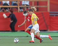 Moncton, New Brunswick - June 17, 2015: First half action. In a FIFA Women's World Cup Canada 2015 Group E match, Brazil (yellow/white) vs Costa Rica (red/blue), 0-0 (halftime), at Moncton Stadium.