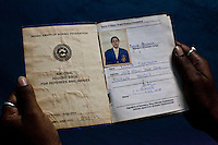 Razia Shabnam's record book of assignments as a referee / judge filled to the brim. She checks her documents as she arrives to referee an all-India invitational boxing competition in the neighbouring town of Burnpur, Calcutta, West Bengal, India. Razia Shabnam, 28, was one of the first women boxers in Kolkata. She was also the first woman in her community to go to college. She is now a coach and one of only three international female boxing referees in India. Photo by Suzanne Lee for Panos London