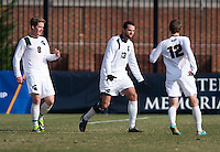 Adam Montague (13) of Michigan State celebrates his goal with teammates Adrew Herr (12) and Brent McIntosh (8) during the third round of the NCAA tournament at Shaw Field in Washington, DC. Michigan State defeated Georgetown, 1-0.