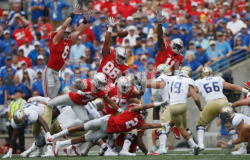 The Ohio State defense can't block a field goal by Tulsa Golden Hurricane place kicker Redford Jones (19) in the first quarter of an NCAA football game between the Ohio State Buckeyes and the Tulsa Golden Hurricane at Ohio Stadium on Saturday, September 10, 2016. (Columbus Dispatch photo by Fred Squillante)