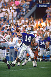 Ty Detmer goes back for a pass during the 1990 opener vs Miami.<br /> <br /> 14 Ty Detmer Quarterback.<br /> <br /> Sept.  1990<br /> FTB 9009 588<br /> <br /> Photo by Mark Philbrick/BYU