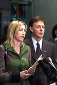 Sir Paul McCartney, right and his girlfriend, Heather Mills, left, speak to reporters following their meeting with United States Secretary of State Colin Powell at the Department of State on April 19, 2001 on the subject of land mines. .Credit: Ron Sachs / CNP