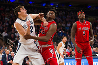 NEW YORK, NY - Thursday March 9, 2017: Dylan Painter (#42) of Villanova and Darien Williams (#45) of St. John's fight for position as the two schools square off in the Quarterfinals of the Big East Tournament at Madison Square Garden.