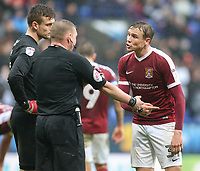Northampton Town's Matthew Taylor remonstrates with referee Richard Clark after he awarded Bolton Wanderers a penalty for a handball in the area<br /> <br /> Photographer Alex Dodd/CameraSport<br /> <br /> The EFL Sky Bet League One - Bolton Wanderers v Northampton Town - Saturday 18th March 2017 - Macron Stadium - Bolton<br /> <br /> World Copyright &copy; 2017 CameraSport. All rights reserved. 43 Linden Ave. Countesthorpe. Leicester. England. LE8 5PG - Tel: +44 (0) 116 277 4147 - admin@camerasport.com - www.camerasport.com