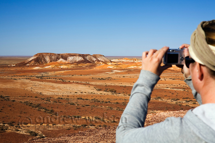 Looking out over The Breakaways - a geological formation of flat topped hills and stony desert formed by an inland sea 70 million years ago.  Breakaways Reserve, Coober Pedy, South Australia, AUSTRALIA.
