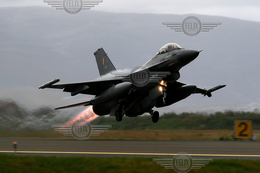 Lockheed Martin F-16 Fighting Falcon from Belgian Air Force 349 squadron taking off with afterburner. BOLD AVENGER 2007 (BAR 07), a NATO  air exercise at &Oslash;rland Main Air Station, Norway. BAR 07 involved air forces from 13 NATO member nations: Belgium, Canada, the Czech Republic, France, Germany, Greece, Norway, Poland, Romania, Spain, Turkey, the United Kingdom and the United States of America. The exercise was designed to provide training for units in tactical air operations, involving over 100 aircraft, including combat, tanker and airborne early warning aircraft and about 1,450 personnel.