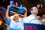 Supporters of Republican presidential hopeful Rick Santorum cheer as the candidate speaks at the Iowa Republican Straw Poll on Saturday, August 13, 2011 in Ames, IA.