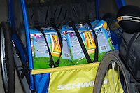 Two 42-pound bags of Fresh Step cat litter strapped in like kids into my bike trailer's child harness.  So cute!