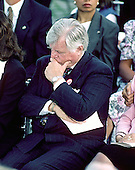 """Arlington, VA - (FILE) -- United States Senator Edward M. """"Ted"""" Kennedy (Democrat of Massachusetts) listens to the speeches at a memorial service honoring his slain brother, former U.S. Senator Robert F. Kennedy (Democrat of New York) on the 25th anniversary of his assassination at Arlington National Cemetery on June 6, 1993. .Credit: Howard L. Sachs / CNP"""