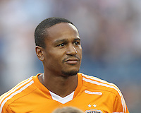 Houston Dynamo midfielder Ricardo Clark (13). In a Major League Soccer (MLS) match, Houston Dynamo (orange) defeated the New England Revolution (blue), 2-1, at Gillette Stadium on July 13, 2013.