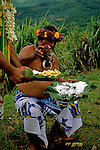 French Polynesia, Tahiti, Taha'a. Tahitian islander demonstrates opening a coconut.