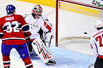 10 February 2010: Washington Capitals' goaltender Jose Theodore gives up a second period goal to the Montreal Canadiens at the Bell Centre in Montreal, Quebec, Canada. The Canadiens defeated the Capitals 6-5 in sudden death overtime, ending Washington's team-record winning streak at 14 games. Mandatory Credit: Ed Wolfstein Photo