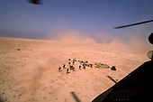 90 miles north of the Kuwait border, Iraq<br /> February 24, 1991<br /> <br /> The 18th Airborne Corp establishes a helicopter refueling station in Iraq, 90 miles north of the Kuwait border.