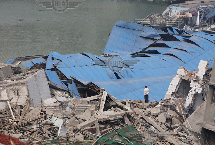Residents search for signs of trapped life under collapsed buildings. An earthquake measuring 7.9 on the richter scale hit Sichuan on 12/05/2008.