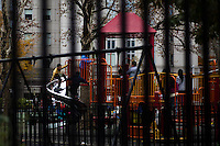 Children play at a public park at Manhattan's Chinatown in New York, Nov 11, 2013. VIEWpress/Eduardo Munoz Alvarez