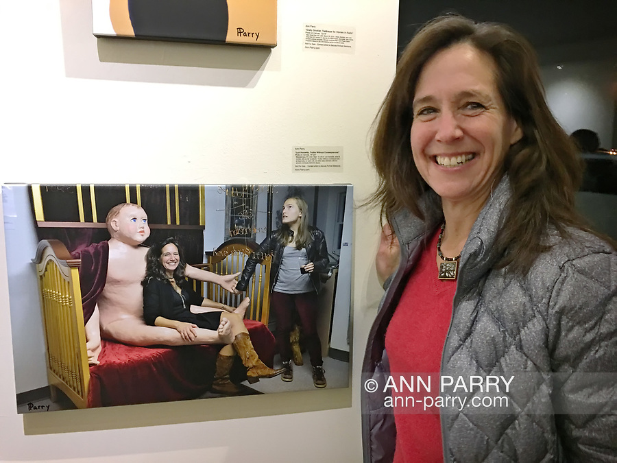 "Huntington, New York, USA. March 5, 2017.  LORI HOROWITZ next to 2014 photo of herself, at Opening Reception for ""Her Story Through Art"" Invitational Art Show, celebrating Women's History Month, at Huntington Arts Council, Main Street Gallery. Artists Tara Leale Porter, Irene Vitale, Anahi DeCanio, Ann Parry, Show March 2 - 25, 2017."