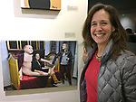"""Huntington, New York, USA. March 5, 2017.  LORI HOROWITZ next to 2014 photo of herself, at Opening Reception for """"Her Story Through Art"""" Invitational Art Show, celebrating Women's History Month, at Huntington Arts Council, Main Street Gallery. Artists Tara Leale Porter, Irene Vitale, Anahi DeCanio, Ann Parry, Show March 2 - 25, 2017."""