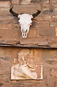 Cow skull and carving of Navajo man Bent Over's Father on wall of building at Hubbell Trading Post National Historic Site, Ganado, Arizona.