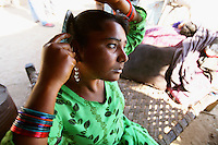 Sex worker Shanti waits for a customer in her village in the Bharatpur region of Rajasthan. Traditionally the Bedia see their women enter the sex trade from the age of 13-14 and many women end up moving to work in bigger cities. Shanti however is blind and works from home, as she is responsible for supporting her entire family...