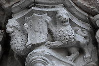 Sculptural detail of lions holding a coat of arms, on the South Portal, 1516-18, by Joao de Castilho, 1470ñ1552, after a design by Diogo de Boitaca, Church of Santa Maria, at the Jeronimos Monastery or Hieronymites Monastery, a monastery of the Order of St Jerome, built in the 16th century in Late Gothic Manueline style, Belem, Lisbon, Portugal. The portal consists of double doors with a tympanum carved with scenes from the life of St Jerome, a statue of Henry the Navigator, many carved statues in niches, a statue of the Madonna and many flamboyant pinnacles and gables in Manueline style. The monastery is listed as a UNESCO World Heritage Site. Picture by Manuel Cohen