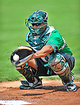 4 July 2012: Vermont Lake Monsters catcher Diomedes Lopez warms up prior to a game against the Hudson Valley Renegades at Centennial Field in Burlington, Vermont. The Lake Monsters edged out the Renegades the Cyclones 2-1 in NY Penn League action. Mandatory Credit: Ed Wolfstein Photo