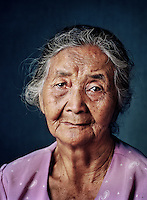 "Icih (born 1926) was one of tens of thousands of 'comfort women' forced into prostitution by the Japanese military during World War II..After her first husband was shot to death by the Japanese, the young widow Icih was put to work as laundry help in nearby barracks. Next she was locked up and raped and battered almost daily for three years by the barracks commander and another serviceman. At first she was still allowed every now and then to walk around the barracks under surveillance. Later she stayed locked up permanently in one of the barracks. She was beaten often and as punishment regularly didn't get food. At the end of the war she went home very thin and sick. ""My father was already dead then, I was the only child. My mother used traditional herbs to heal my wounds, rubbed me with crushed leaves and massaged my body. I wasn't able to walk anymore, not even capable of pronouncing my name."" Icih didn't remarry until eight years after the war, when she was fully recovered and could work again. ""My husband knew I was taken by the Japanese, I told him myself, but he didn't care."" The marriage ended in divorce after a few years, as did her next 10 marriages. She was never able to bear children; her womb was damaged by internal injuries sustained at the barracks. She adopted three children of her deceased sister. They in turn help her out in her old age, though she still consistently labours as a farm worker. She is at peace with her existence, but the rapes continue to haunt her. ""It hurt so much, it was as if heaven crashed onto earth. My body can't forget it.""."