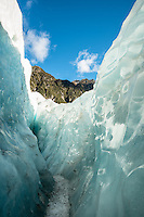 Walking through crevasse on Franz Josef Glacier, Westland Tai Poutini National Park, West Coast, UNESCO World Heritage Area, South Westland, New Zealand, NZ