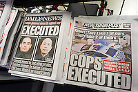 The New York Daily News and the New York Post report on Sunday, December 21, 2014 about the assassination of two NYPD officers, Wenjian Liu and Rafael Ramos by Ismaaiyl Brinsley.  The officers were murdered in Brooklyn in their squad car by Brinsley allegedly in retaliation for the Eric Garner death. Brinsley killed himself in the subway during his attempted escape. (© Richard B. Levine)