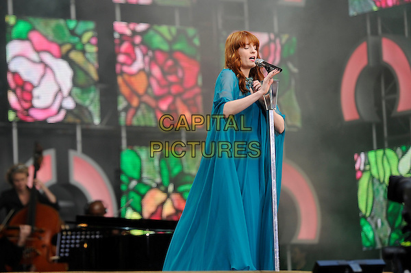 Florence Welch (of Florence and the Machine)<br /> Performing at the 'Chime For Change' concert, Twickenham Stadium,  London, England. 1st June 2013 <br /> music live on stage gig half length turquoise dress teal blue sheer microphone dress cape sleeves singing <br /> CAP/MAR<br /> &copy; Martin Harris/Capital Pictures