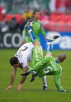 25 April 2010: Seattle Sounders midfielder Osvaldo Alonso #6 collides with Toronto FC midfielder Nick LaBrocca #21 during a game between the Seattle Sounders and Toronto FC at BMO Field in Toronto..Toronto FC won 2-0....