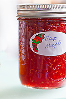 Bright glass jars of jams and jellies.