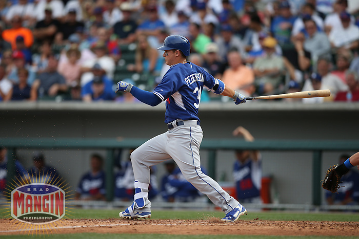 MESA, AZ - MARCH 11:  Joc Pederson of the Los Angeles Dodgers bats against the Chicago Cubs during a spring training game at Sloan Park on March 11, 2015 in Mesa, Arizona. (Photo by Brad Mangin)