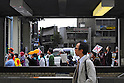 Tokyo, Japan - April 15: A man walked on a sidewalk as a demonstration against nuclear power plants marched at Ikebukuro, Toshima, Tokyo, Japan on April 15, 2012. This was the first time in the big city and organized by a local couple, Mr. and Mrs. Makabe. It was promoted via twitter and its blog, and approximately 250 people showed up.