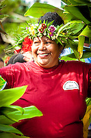 A woman wears a floral headband and a smile during Makirau Haurua's investiture with the Teurukura Ariki title, Aitutaki Island, Cook Islands.