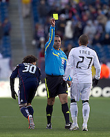 Referee Baldomero Toledo issues yellow card to DC United forward Fred Carreiro (27). In a Major League Soccer (MLS) match, the New England Revolution defeated DC United, 2-1, at Gillette Stadium on March 26, 2011.