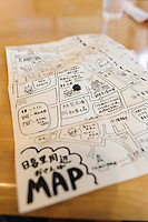 """A hand drawn map for tourists, Yanaka, Tokyo, Japan, April 19, 2012. Yanaka is part of Tokyo's """"shitamachi"""" historic working class wards. Recently it has become popular with Japanese and foreign tourists for its many temples, shops, restaurants and relaxed atmosphere."""