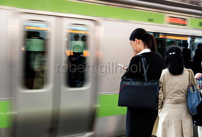 People wait for Yamanote Line train at Shinjuku Station in Tokyo Japan on April 22, 2016. Rob Gilhooly Photo