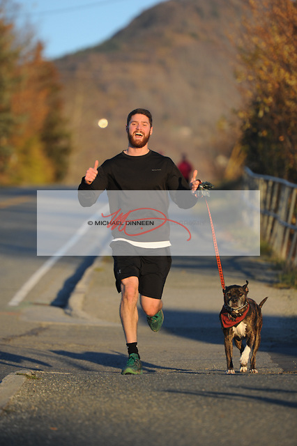Alec Levesque and his dog Diesel head down Monte Road in Eagle River Thursday, Oct. 6, 2016.  Photo by Michael Dinneen