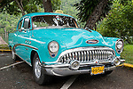 Las Terrazas, Cuba; a teal blue classic 1956 Buick Super in a parking lot at Las Terrazas