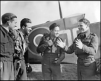 BNPS.co.uk (01202 558833)<br /> Pic: AndySaundersCollection/BNPS<br /> <br /> Colin Hodgkinson with fellow pilots at an Operational Training Unit, October 1942.<br /> <br /> he remarkable story of a British hero double amputee pilot who took to the skies during the Second World War has come to light.<br /> <br /> Flight Lieutenant Colin Hodgkinson lost his legs in a horror crash in a Tiger Moth in May 1939 but went on to emulate Sir Douglas Bader and fly Spitfires in the Royal Air Force.<br /> <br /> He even endured a spell in the Great Escape prisoner of war camp after being shot down over France in 1943 but rejoined the RAF after being repatriated.<br /> <br /> The pair were the only two British double amputee pilots to fly during the war - yet while Bader, rightly, is a household name, Flt Lt Hodgkinson's exploits have been largely forgotten.<br /> <br /> This has prompted historian Mark Hillier to publish Flt Lt Hodgkinson's autobiography 60 years after it was penned which he hopes will shine some limelight on a 'special' man whose courage he says was every bit as great as Baders'.<br /> <br /> Best Foot Forward, by Colin Hodgkinson, is published by Pen &amp; Sword.