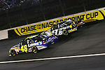 Oct. 17, 2009; Jimmy Johnson (48) fights for the lead as he passes Matt Kenseth (17) at the NASCAR Banking 500 Sprint Cup Series event sponsored by Bank of America,  run at  Lowe's Motor Speedway in Charlotte, NC., Banking 500