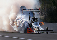 Mar 19, 2016; Gainesville, FL, USA; Smoke pours from the engine of NHRA top fuel driver Clay Millican during qualifying for the Gatornationals at Auto Plus Raceway at Gainesville. Mandatory Credit: Mark J. Rebilas-USA TODAY Sports
