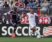 DC United defender Robbie Russell (3) clears the ball as New England Revolution forward Saer Sene (39) closes. In a Major League Soccer (MLS) match, DC United defeated the New England Revolution, 2-1, at Gillette Stadium on April 14, 2012.