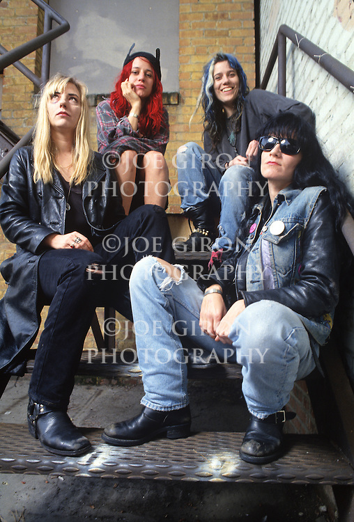 Various portraits & live photographs of the rock band, L7. Concert