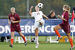 05 November 2008: Florida State's Sanna Talonen (25) plays the ball between Virginia Tech's Kelsey Billups (23) and Jennifer Harvey (right). Virginia Tech and Florida State University played to a 0-0 tie after two overtimes at Koka Booth Stadium at WakeMed Soccer Park in Cary, NC in a women's ACC tournament quarterfinal game.  Virginia Tech advanced to the semifinal round in penalty kicks, 4-2.