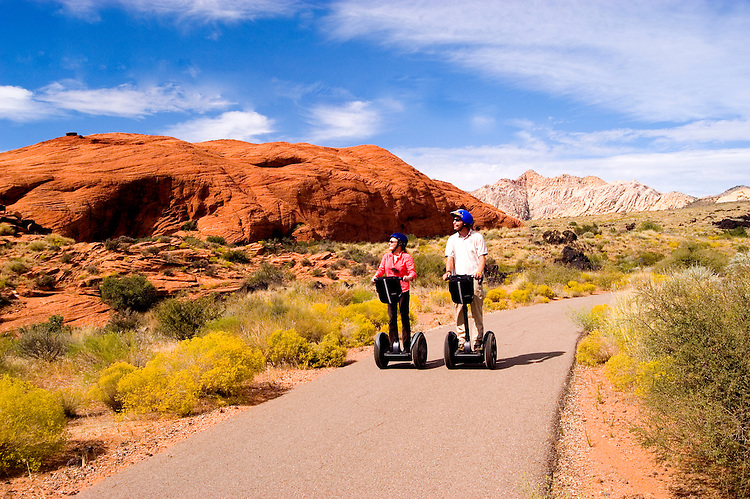 Couple on Seqways at Snow Canyon State Park, Utah, UT, scenic, landscape, Segways, Segway riders, model released, rock formations, landforms, arid, Southwest America, American Southwest, US, United States, Image ut410-18585, Photo copyright: Lee Foster, www.fostertravel.com, lee@fostertravel.com, 510-549-2202
