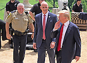Donald Trump, a candidate for the 2016 Republican nomination for President of the United States, shares a thought with unidentified security staff as he walks back into the house after appearing at the ribbon cutting for the Albemarle Estate at the Trump Winery in Charlottesville, Virginia on Tuesday, July 14, 2015. <br /> Credit: Ron Sachs / CNP<br /> <br /> (RESTRICTION: NO New York or New Jersey Newspapers or newspapers within a 75 mile radius of New York City)